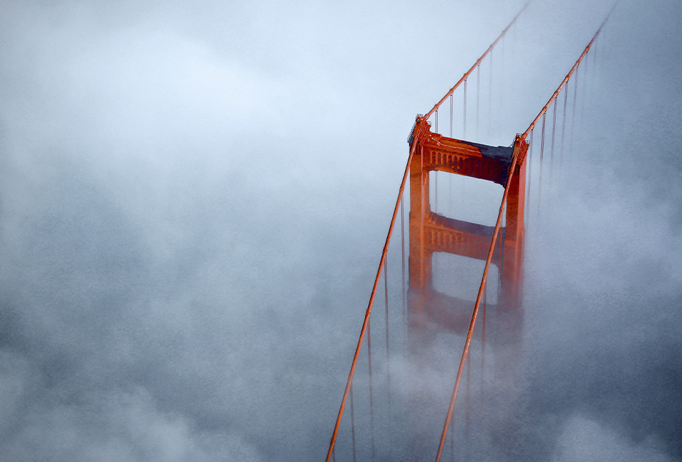 Bridge tower amidst clouds